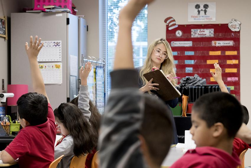 Corina Pannabecker teaches first grade at Ogden Elementary in San Antonio. Bexar County's school districts are among the most segregated in the state, with boundary lines historically drawn to consolidate resources. San Antonio ISD is working to create more socioeconomic and racial diversity through public school choice measures.