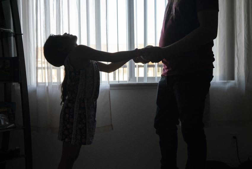 Heyli plays with her dad in their apartment in Los Angeles, California. Besides dealing with separation anxiety due to the n…