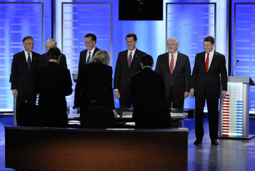 Rick Perry and the other GOP candidates on stage before ABC News debate in Manchester New Hampshire 01/07/12.