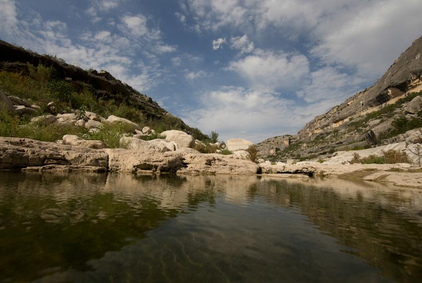 The upper reaches of Dead Man's Canyon of the Pecos River with lower-than average water levels in the Pecos River just wes...