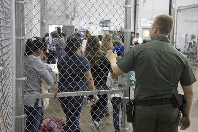 In a photo provided by U.S. Customs and Border Protection, undocumented immigrant children are shown at a U.S. Border Patrol processing center in McAllen.