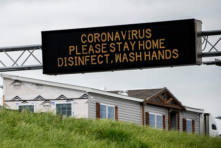A sign warns drivers to stay home because of coronavirus on I-85 in Montgomery, Alabama on March 21, 2020.