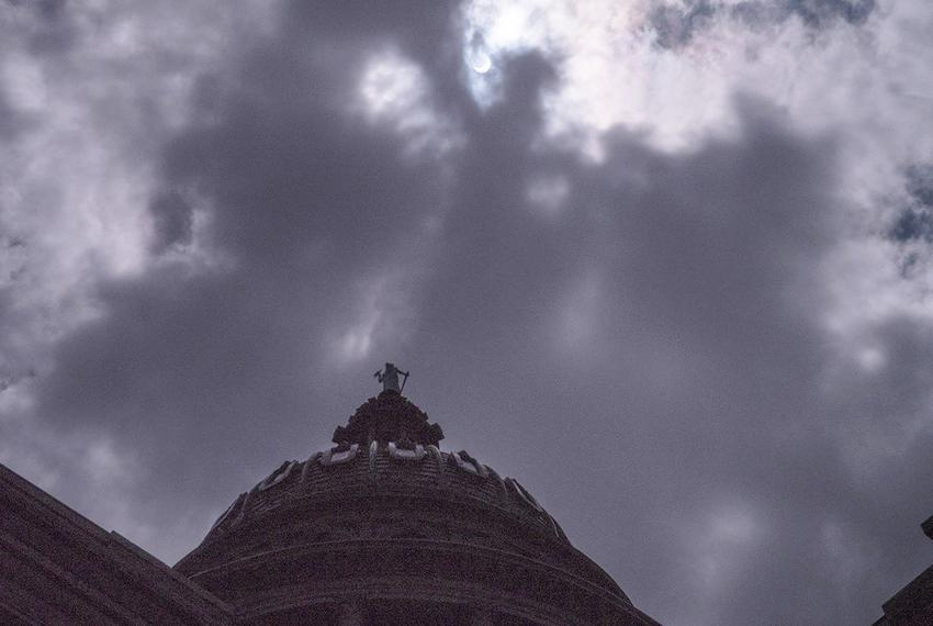 An eerie light suffuses the Capitol dome during the partial eclipse of the sun in Austin on Aug. 21, 2017.