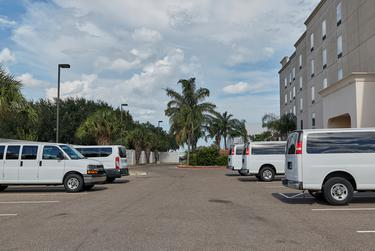 Vans outside a Hampton Inn where migrant children were being detained in McAllen.