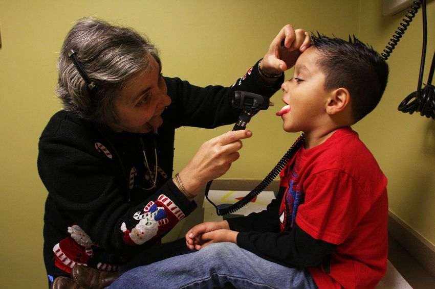 Dr. Sarah Helfand exams a patient during his checkup at Kessler Pediatrics in Dallas.