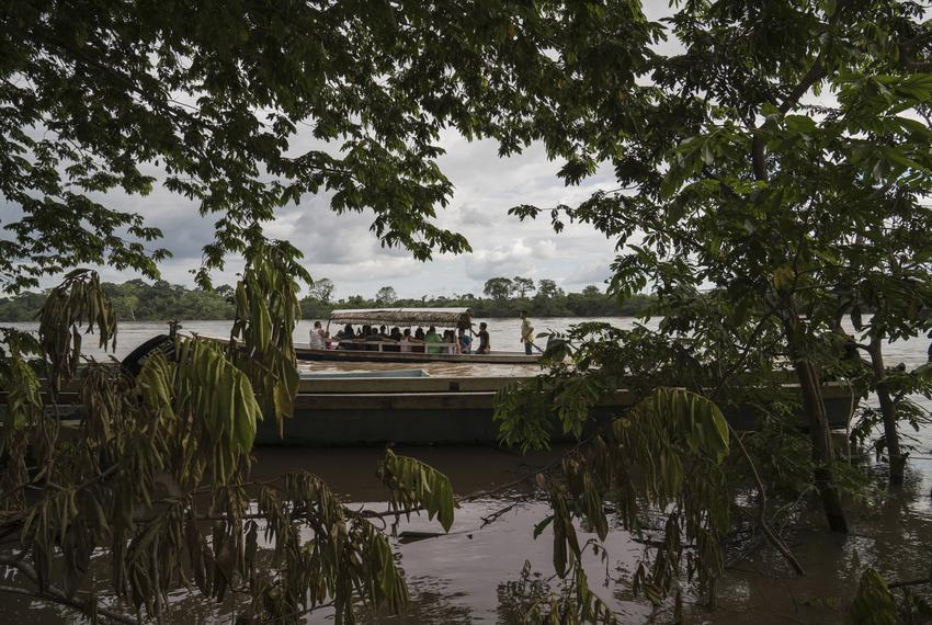 Migrants cross the Usumacinta River between La Técnica, Guatemala, and Frontera Corozal, México, on Oct. 21. The Usumacint...