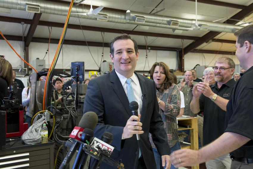 U.S. Sen Ted Cruz is welcomed at LaRue Tactical, a gun manufacturer in Leander, by founders Ellen LaRue, center, and Mark La…