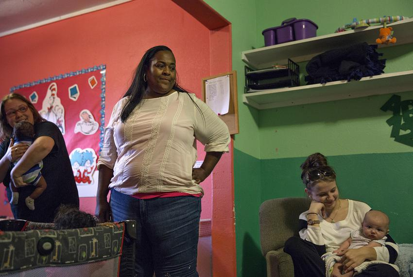 Jacqueline James looks over at infants playing in the only building in her child care center that did not suffer severe da...