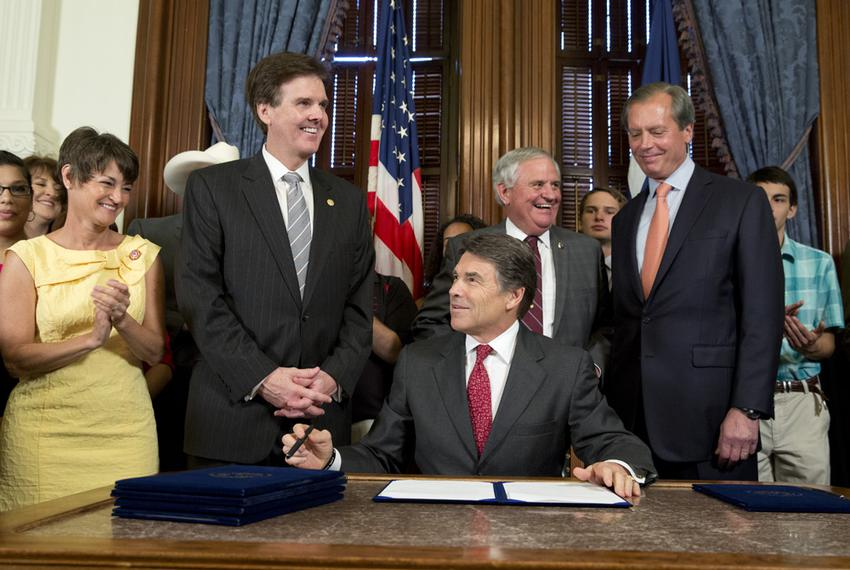 Gov. Rick Perry after signing House Bill 5, an education reform bill, before a crowd in the Governor's Reception Room on J...