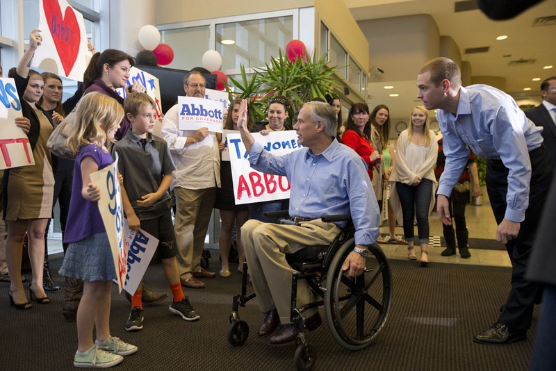 Greg Abbott arrives to a friendly crowd at Signature Aviation on the eve of election day Nov. 3, 2014.