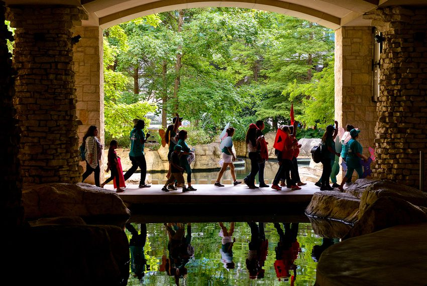 """Protesters march near the Riverwalk in San AntonioagainstSenate Bill 4, the """"sanctuary cities"""" ban, on June 26, 2017. U.S. District Judge Orlando Garcia is hearing opening argumentsfrom Texas cities and counties challenging the measure, signed into law by Gov. Greg Abbott."""