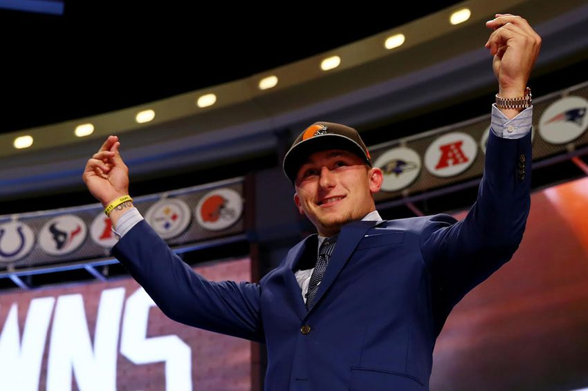 Former A&M quarterback Johnny Manziel recently drafted by the NFL Cleveland Browns was drafted by the San Diego Padres in the 28th round of the Major League Baseball First-Year Player Draft. NEW YORK, NY - MAY 08:  Johnny Manziel of the Texas A&M Aggies takes the stage after he was picked #22 overall by the Cleveland Browns during the first round of the 2014 NFL Draft at Radio City Music Hall on May 8, 2014 in New York City.
