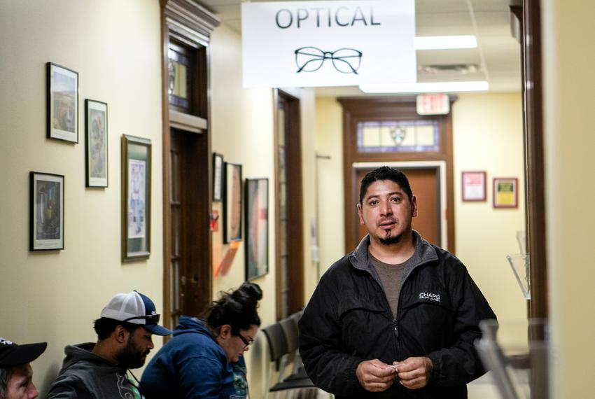 Eliecer Arce walks out of the exam room at Community Eye Clinic after a follow up appointment. Dec 4, 2018.