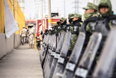 The Mexican military guards the perimieter of the shelter where an estimated 1700 migrants are currently being held in Piedras Negras. Feb. 12, 2019.