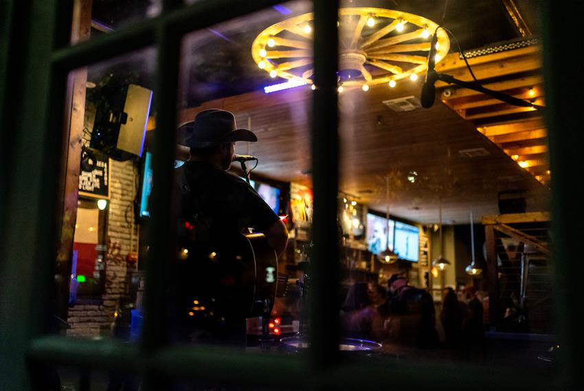 The San Jac Saloon attracts customers with drink specials and live music on May 22, 2020.