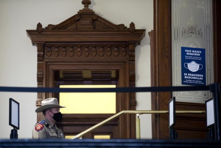 A state trooper stand guard outside of the door to the House chamber on opening day of the legislative session on Jan. 12, 2…