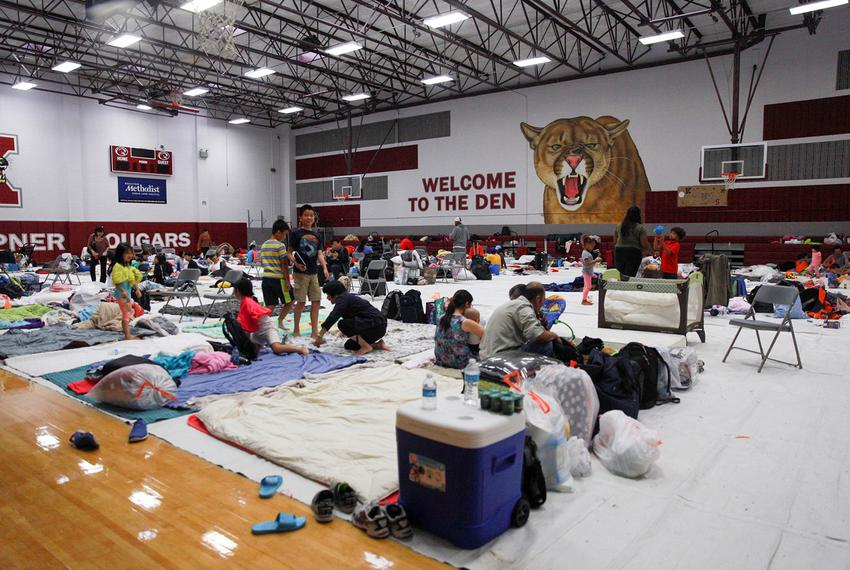 The gym at Kempner High School in Sugarland, in Fort Bend County southwest of Houston, was converted to a shelter during H...