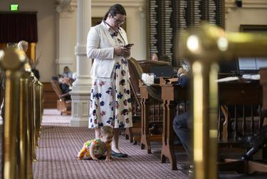 State Rep. Erin Zwiener, D-Driftwood, with her daughter on the House floor during the House School Finance plan deliberation on April 3, 2019.