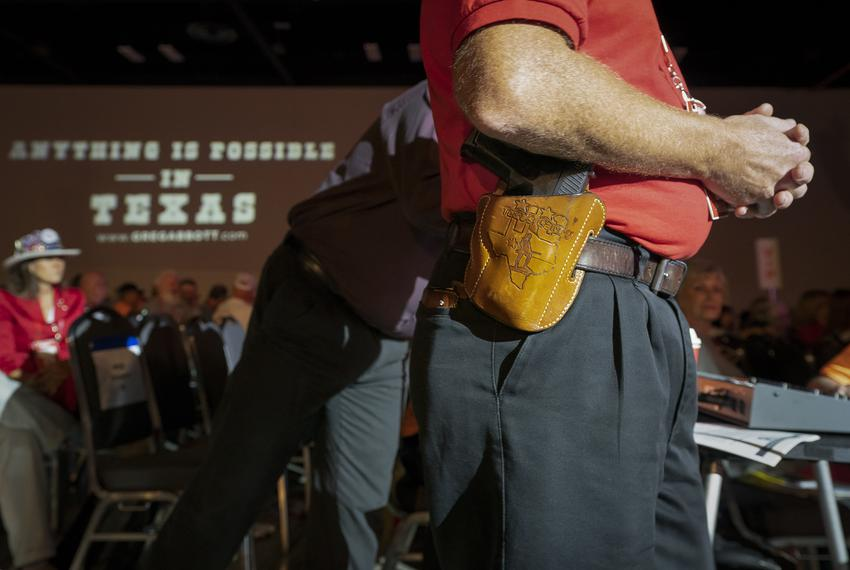 Terry Holcomb waits to ask a question while open carrying at the Texas Republican Convention in San Antonio on June 14, 2018.