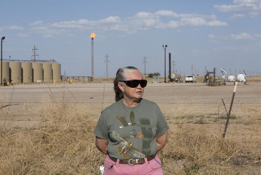 Sue Franklin in front of a flare near her home near Balmorhea, Texas on April 11, 2018.
