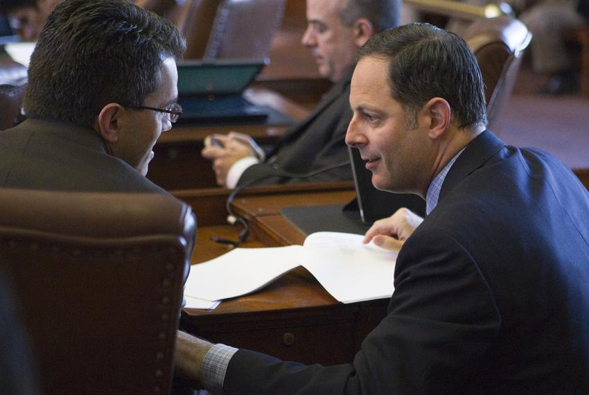 State Rep. Rafael Anchia, D-Dallas, speaks with fellow Rep. Mark Strama, D-Austin, after 2013 committee assignments are anno…