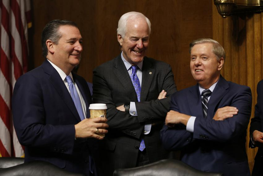 Left to right: Republican Sens. Ted Cruz, John Cornyn and Lindsey Graham during a break in the hearing on the nomination of …