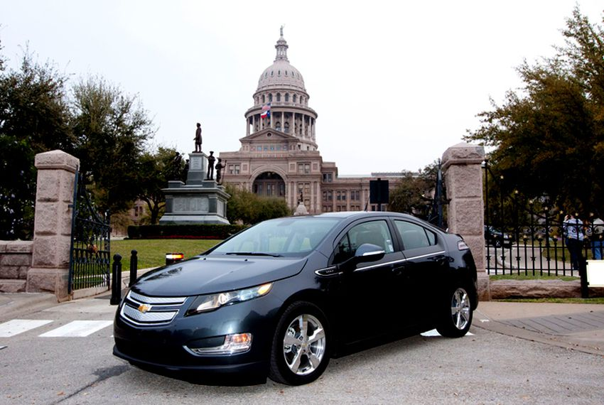 The Volt, a plug-in hybrid car made by General Motors, in front of the Texas Capitol.