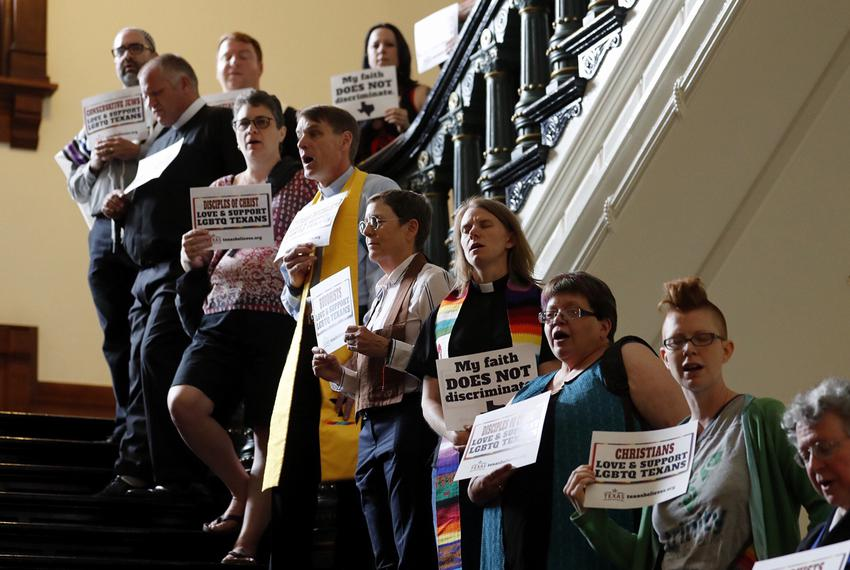 Members of the clergy and others supporting LGBT rights gather outside the Texas House chamber May 3, 2017 to show support f…