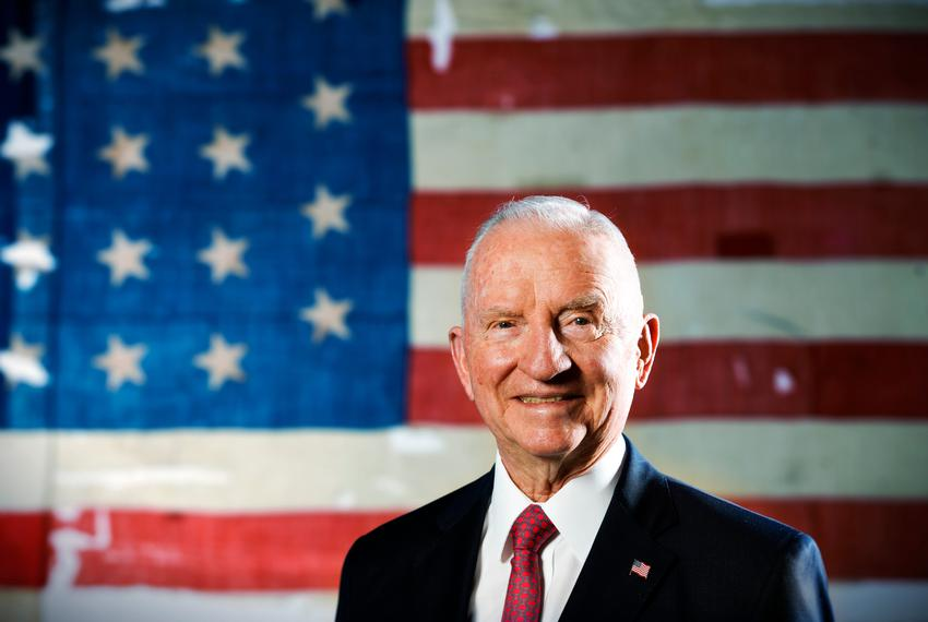 "Former Presidential candidate Ross Perot stands in front of a historic flag from the USS Constitution, also known as ""Old ..."