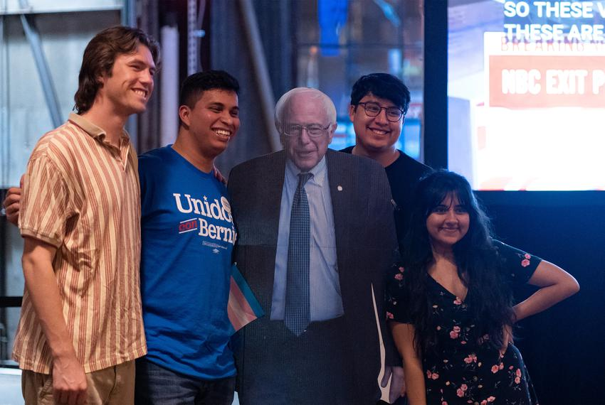 From left: Neil Hernandez, Hiram Garcia, Luke Lee, and Dhvani Shukla pose with a cardboard cutout of Bernie Sanders at a S...