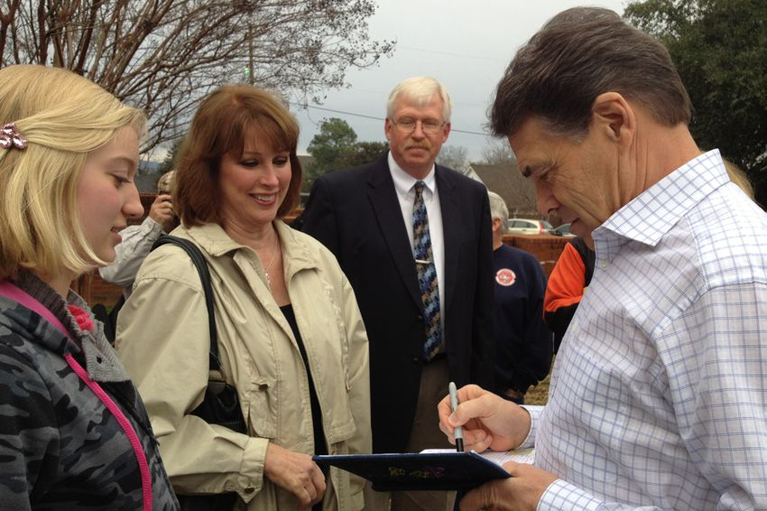 Rick Perry signs an autograph in Pickens, South Carolina.