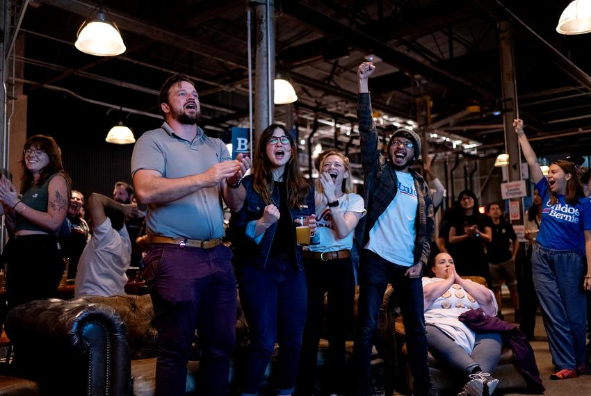 At a Bernie Sanders Super Tuesday Watch Party in Austin, TX, Sarah Stuchberry, James Lamarche, and Julia Mason cheer as Be...