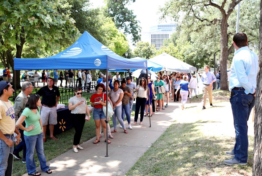 Blood donors lined up outside mobile stations at the Texas Capitol on Monday to support the victims of Saturday's mass shooting in El Paso.