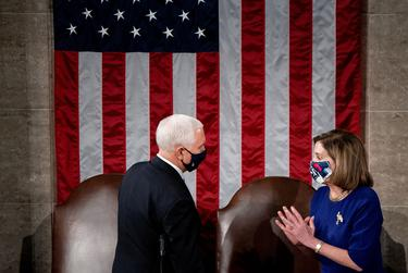 House Speaker Nancy Pelosi, D-California, and Vice President Mike Pence take part in a joint session of Congress to certify the 2020 election results on Capitol Hill in Washington, U.S., Jan. 6, 2021.