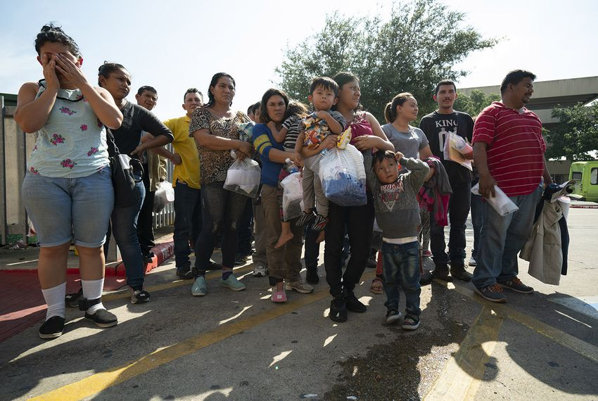 Immigrants, many wearing ankle monitors, are dropped off at the McAllen Central Station, where they are they are given bus tickets to other parts of the country. On Saturday, June 23, 2018. Reynaldo Leal for The Texas Tribune