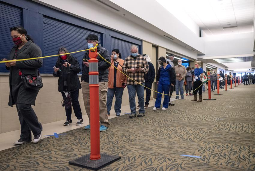 Tarrant County residents wait in line to receive the COVID-19 vaccine at the Esports Stadium in Arlington on Jan. 05, 2021.