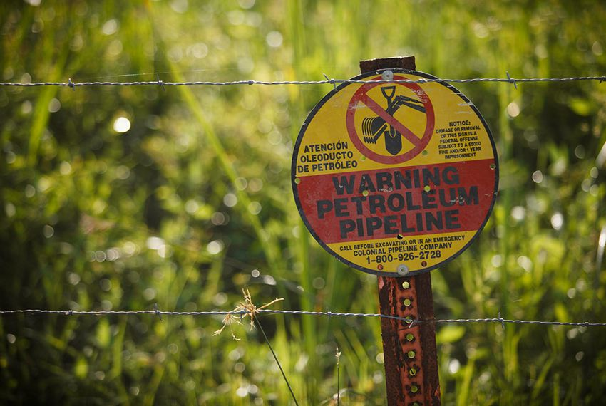 One of the many pipeline markers sprinkled across David Holland's family farm near Beaumont, Texas. Holland is involved in major litigation involving common carrier status against Denbury Resources, which built a pipeline across his land.