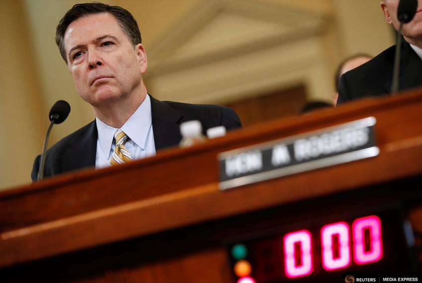 FBI Director James Comey testifies on Capitol Hill before the House Intelligence Committee hearing into alleged Russian medd…