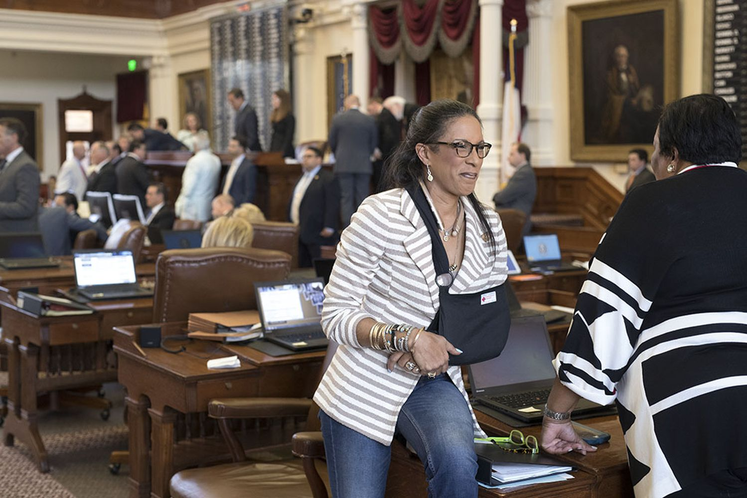 State Rep. Dawnna Dukes, D-Austin, chats on the House floor on August 1, 2017. Dukes faces a deadline to resign from office or face corruption charges from the Travis County District Attorney's Office.