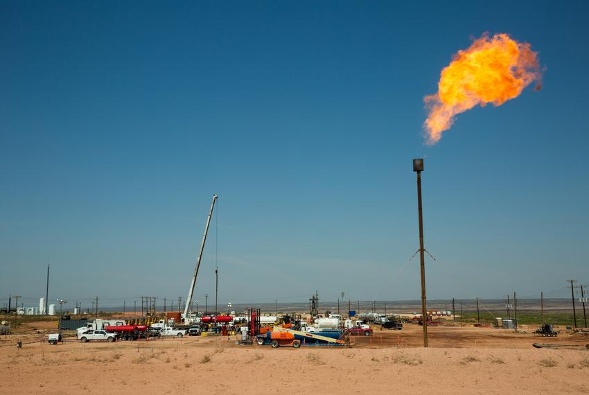 A flare burns on May 24, 2018, atop a drill pad on land near Carlsbad, N.M., that Wayne Smith leased for ranching before h...