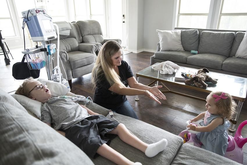 Beth Moore plays with two of her children, William, 6, and Mary, 2, who both have spinal muscular atrophy. Moore asked the...