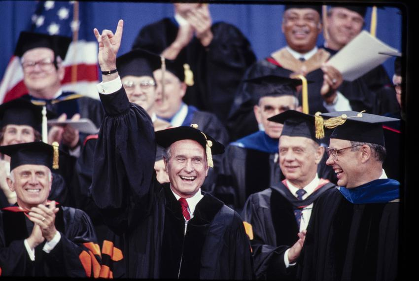 Bush receives an honorary degree from the University of Texas at Austin in 1990.