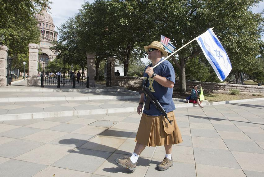 Almost forgotten in the midst of Texas Muslim Capitol Day, an open carry advocate displays his gun and the Israeli flag on J…