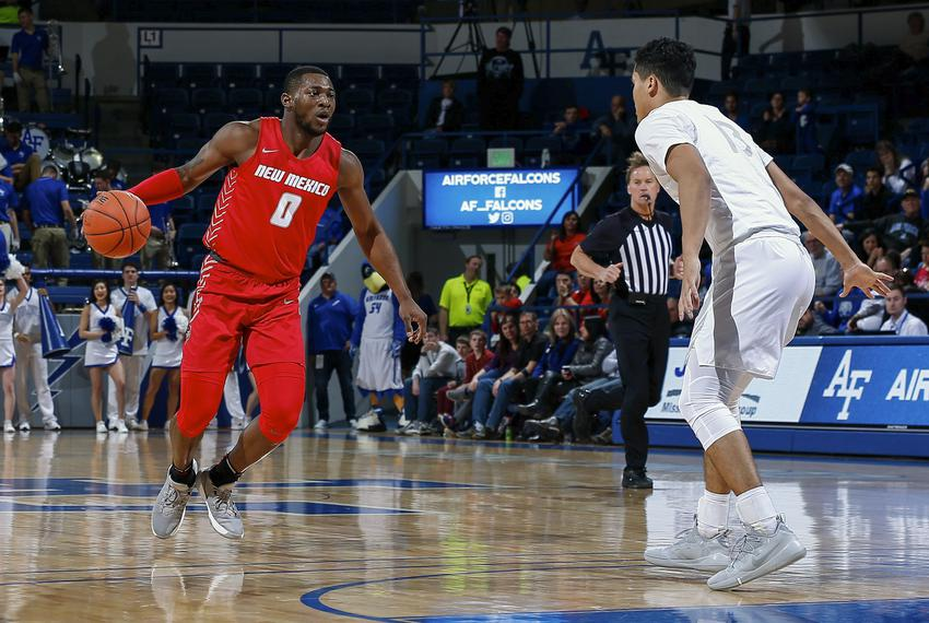 New Mexico Lobos guard Zane Martin controls the ball in a game against the Air Force Falcons at Clune Arena in Colorado. Feb…