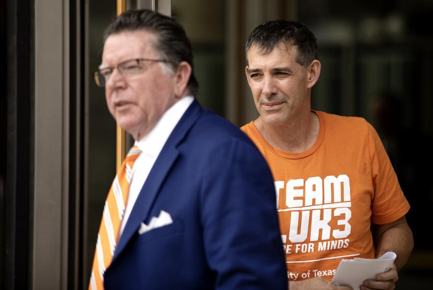 UT men's tennis coach Michael Center exits the U.S. Federal Courthouse in Austin on March 12, 2019. The university placed Ce…