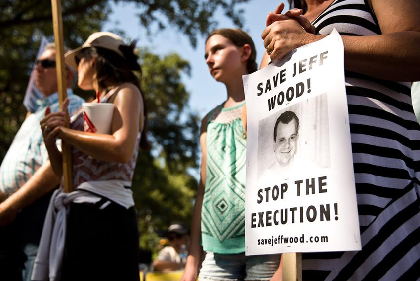 Supporters of Jeff Wood gathered on July 23, 2016, in front of the Governor's Mansion to rally against his scheduled August …