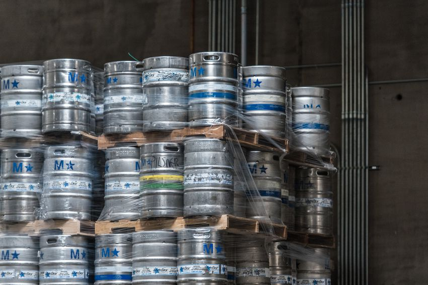 Kegs packaged for distribution sit near the taproom at Oskar Blues Brewery in Austin, Texas, on June 2, 2017.