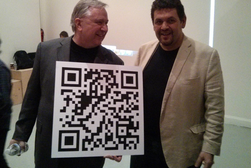 U.S. Rep. Steve Stockman, R-Friendswood, holds a QR code linked to a Bitcoin account at an event at the NYC Bitcoin Center i…