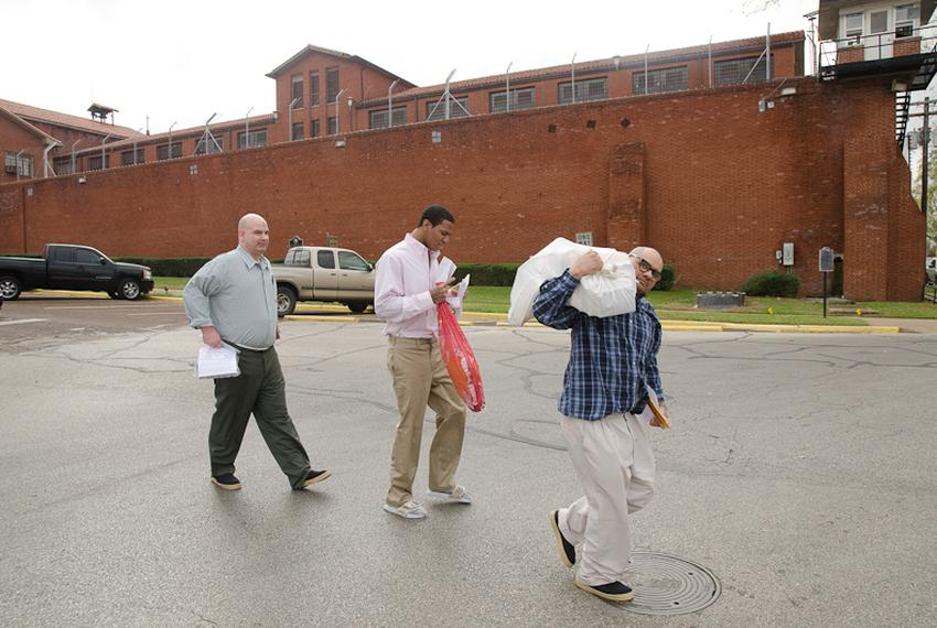 William Crow, Elliott Cornett and Daniel Barraza, all recently released inmates, walk away from the Walls Unit in Huntsville…