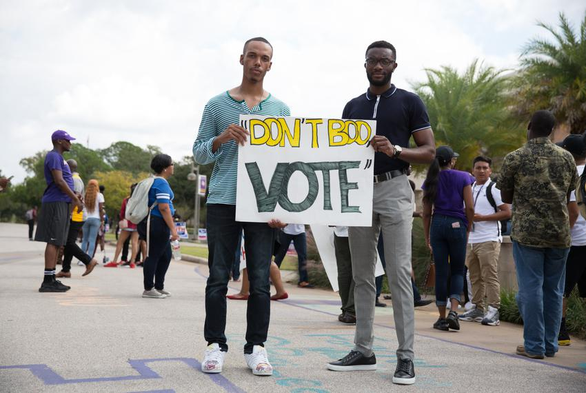 Jeremy Butler (l.) and Odaro Adu stand outside the Willie A. Tempton Student Center at Prairie View A&M University encouragi…